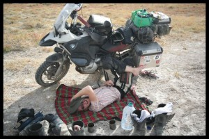 Having a break in the shade near a salt lake - Gobi Desert